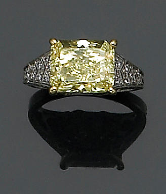 A natural fancy color diamond, diamond, platinum and gold ring