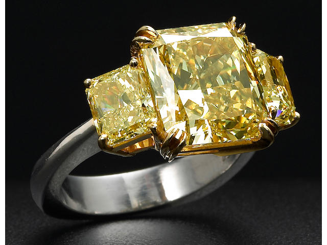 A natural fancy color diamond, platinum and eighteen karat gold ring