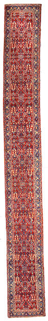A Heriz runner Northwest Persia size approximately 2ft 3in x 18ft 10in
