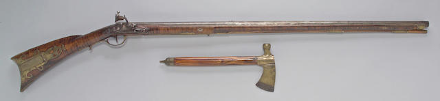 An American full-stocked flintlock buck and ball gun and tomahawk attributed to John Young