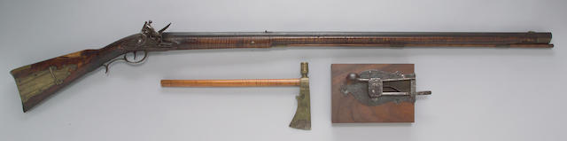 An American full-stocked flintlock rifle and pipe tomahawk by Jacob Welshans, Sr.