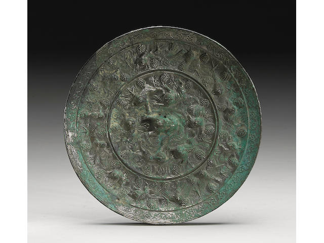 A fine bronze lion and grapevine mirror Tang Dynasty