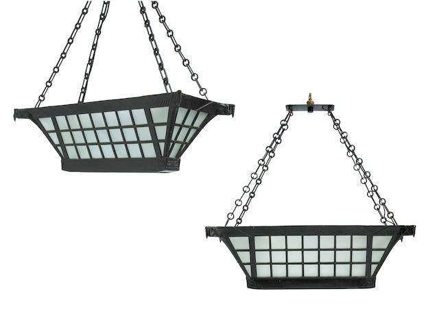 A pair of Max Le Verrier Art Deco black painted metal and frosted glass chandeliers