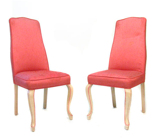 A set of sixteen Louis XV style paint decorated and upholstered dining chairs