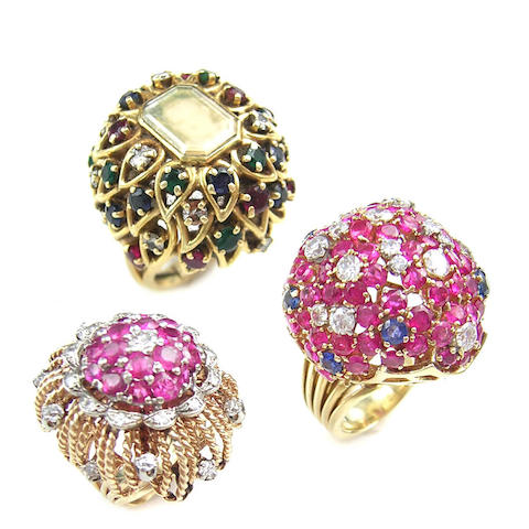 A collection of three ruby, diamond, and sapphire dome rings