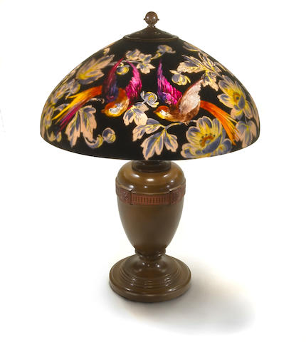 A Handel reverse painted and patinated metal 'Bird of Paradise' lamp