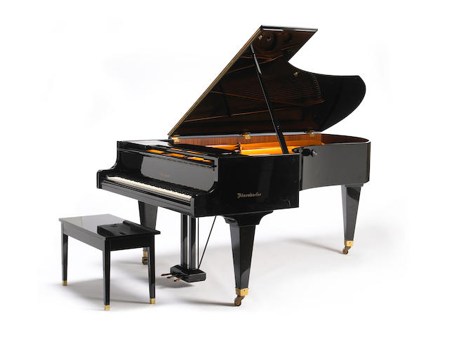 A Bosendorfer ebonized grand piano with matching bench