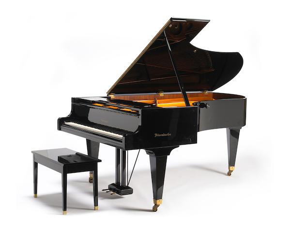 A Bosendorfer ebonized grand piano with matching bench
