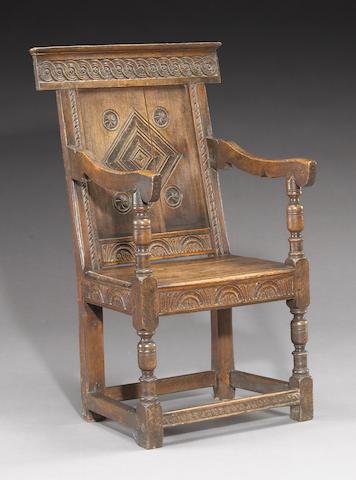 An English Baroque oak wainscot armchair