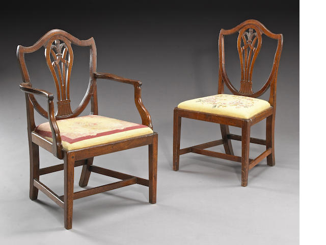 An assembled set of nine George III and George III style mahogany dining chairs