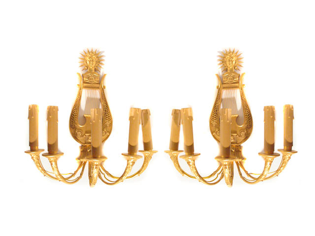 A pair of Empire style gilt bronze five light bras de lumiere