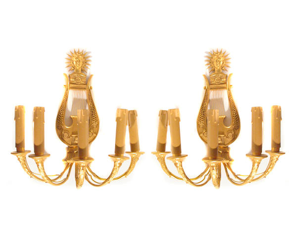 A pair of Empire style gilt bronze five light bras de lumiere