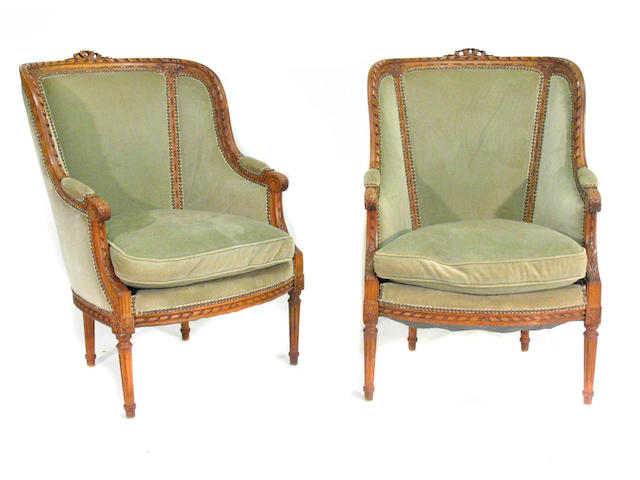 A pair of Louis XVI style beechwood bergeres