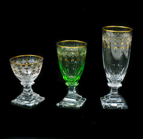 A group of gilt decorated and etched stemware