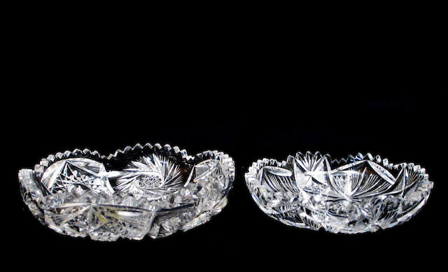A group of three cut glass circular low dishes
