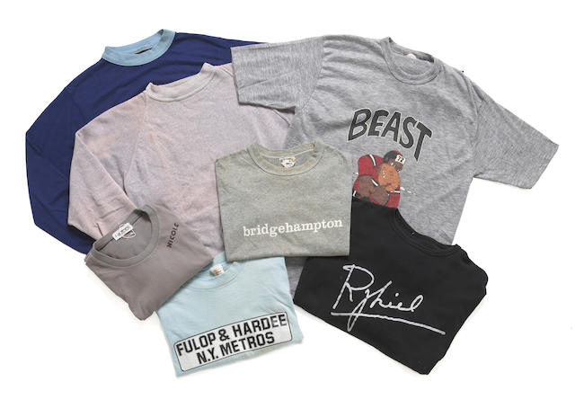 A group of t-shirts and sweatshirts