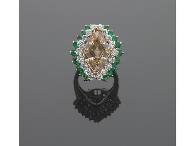 A fancy colored diamond, diamond, emerald, eighteen karat gold and platinum ring
