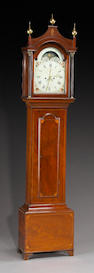 A George III brass mounted and inlaid mahogany inlaid tall case clock