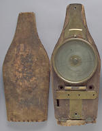 A cased surveyor's brass vernier compass