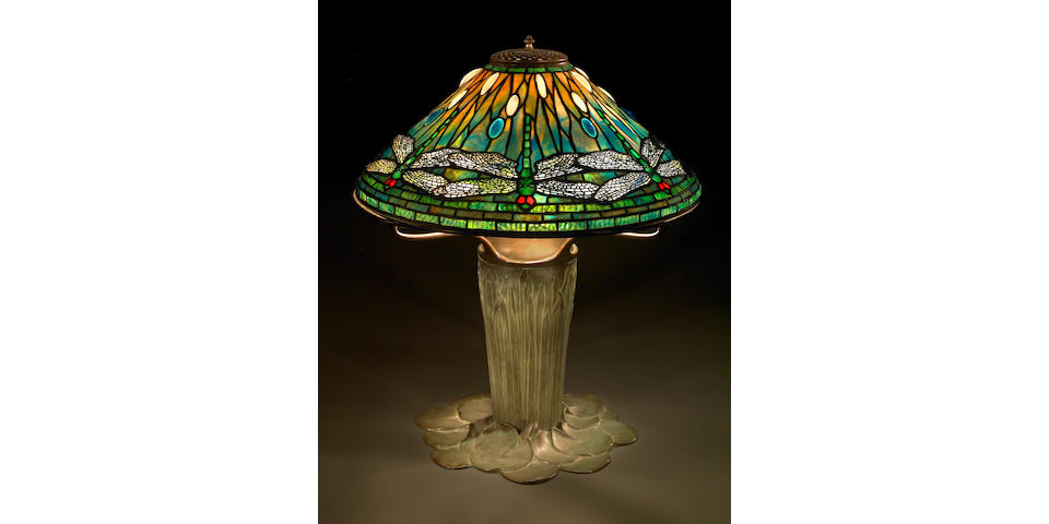 A Fine Tiffany Favrile glass and bronze dragonfly lamp on a cattail base
