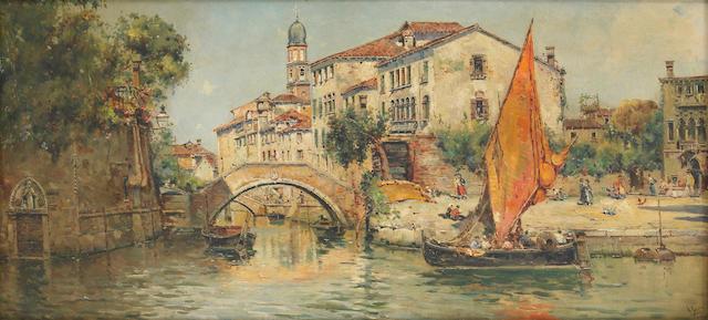 Antonio María de Reyna Manescau (Spanish 1859-1937) A view of a canal in Venice 14 x 29 1/2in (35.5 x 74.9cm)