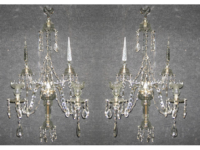 A pair of cut glass sconces