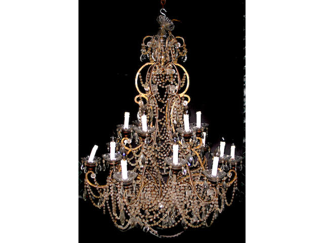A Louis XV style patinated metal cut glass chandelier