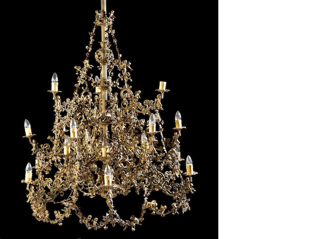 A Spanish Colonial gilt bronze twenty-one light chandelier of monumental size