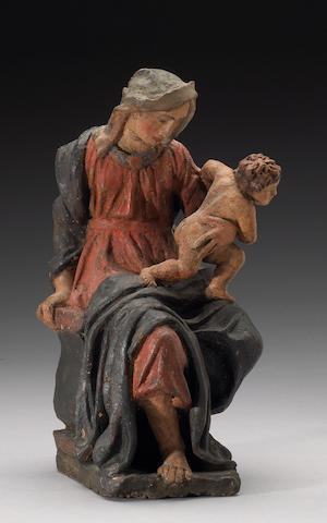An Italian polychrome terracotta figure of the Madonna and Child