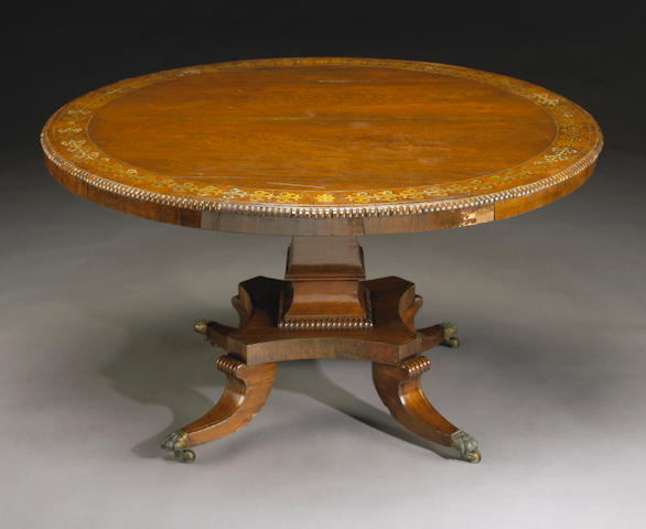 A Regency brass-inlaid rosewood breakfast table