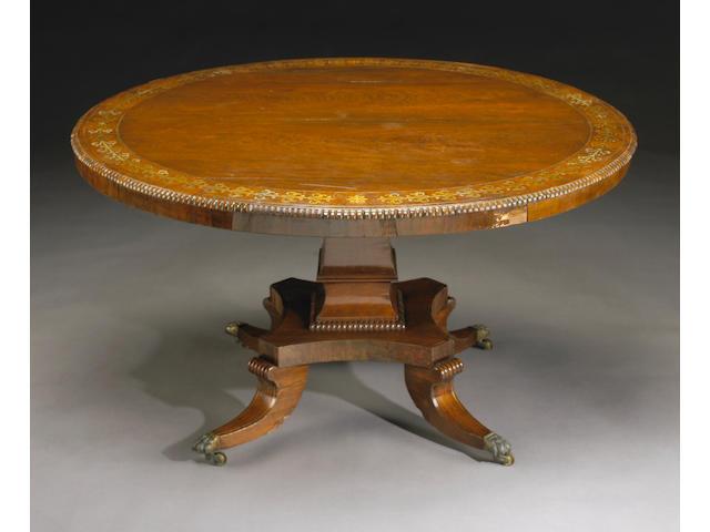 A Regency brass-inlaid rosewood breakfast table