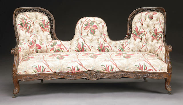 A Victorian pierce-carved rosewood sofa