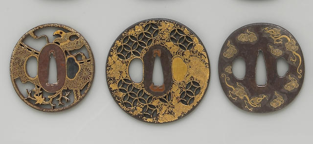 Three gold inlaid iron tsuba Edo Period