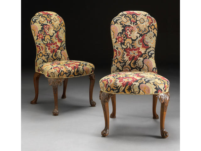 A set of ten George I style carved walnut dining chairs
