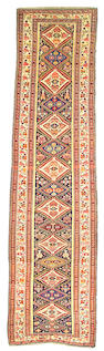 A Caucasian runner size approximately 3ft x 12ft 4in
