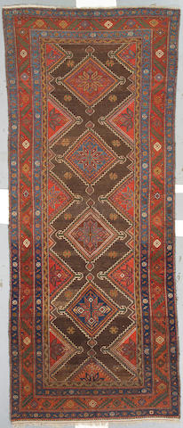 A Malayer runner Central Persia size approximately 4ft 6in x 11ft 3in