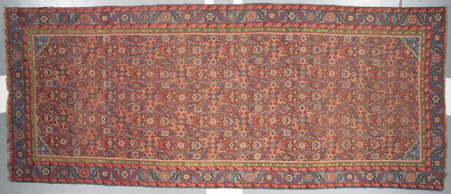 A Northwest Persian long carpet size approximately 6ft 11in x 16ft 8in