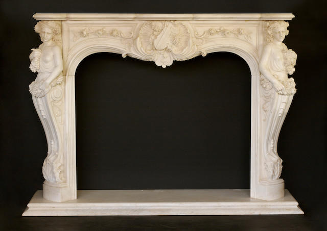 A Louis XV style carved marble fire surround
