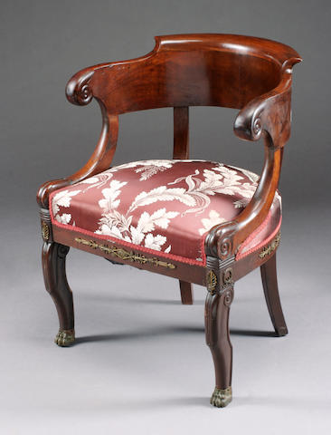 An Empire style gilt bronze mounted mahogany bergere