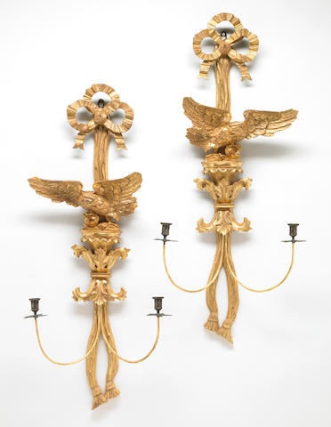A pair of George III style carved giltwood wall lights