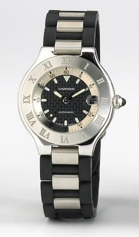 Cartier. A stainless steel and rubber self-winding calendar bracelet watch21 Autoscaph, circa 2002