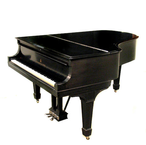 A Steinway & Sons ebonized grand piano and bench