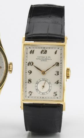 Patek Philippe & Co, retailed by Tiffany & Co. A fine 18k gold rectangular wristwatch with Breguet style numerals Case No.522839, Movement No.834590, circa 1941