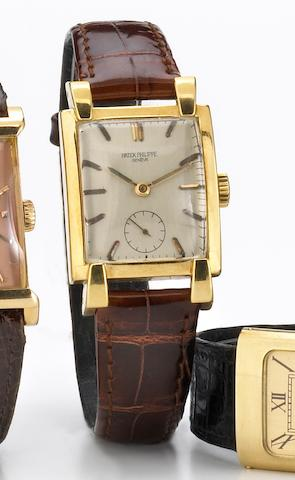 Patek Philippe. A fine and unusual 18k gold large rectangular wristwatch with prominent lugsRef.2427, Case No.512712, Movement No.974059, circa 1952