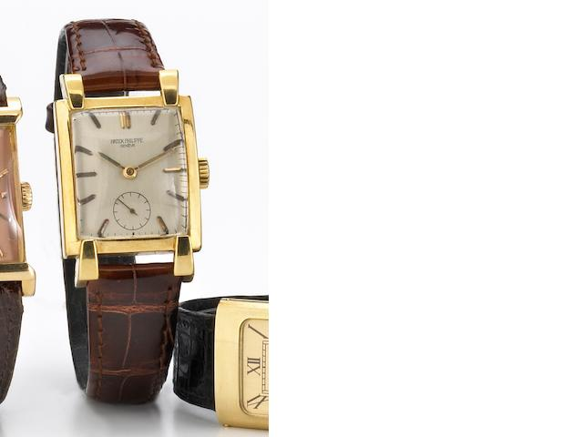 Patek Philippe. A fine and unusual 18k gold large rectangular wristwatch with prominent lugs Ref.2427, Case No.512712, Movement No.974059, circa 1952