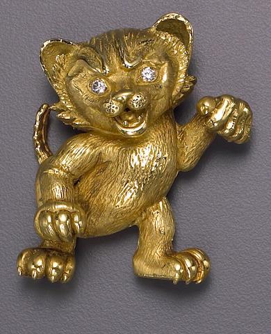 An eighteen karat gold and diamond-set brooch