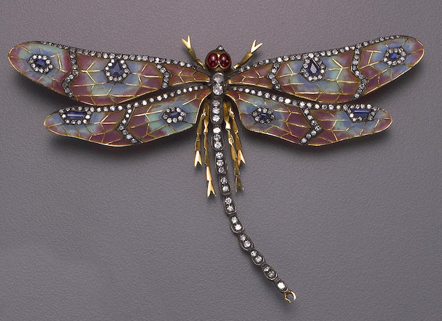 An enamel, diamond, gem-set and silver topped eighteen karat gold dragonfly brooch