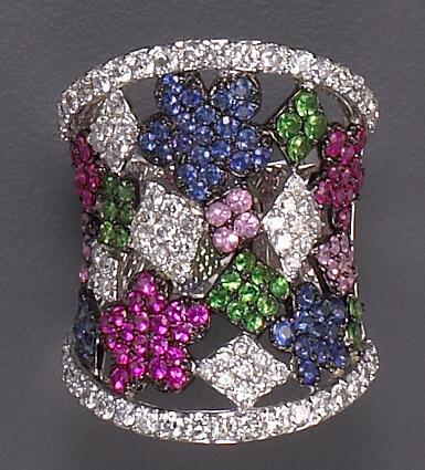 A diamond, gem-set and eighteen karat white gold ring