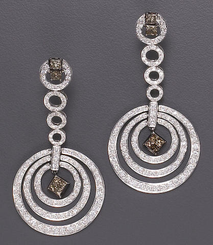 A pair of diamond, brown diamond and eighteen karat white gold pendant earrings