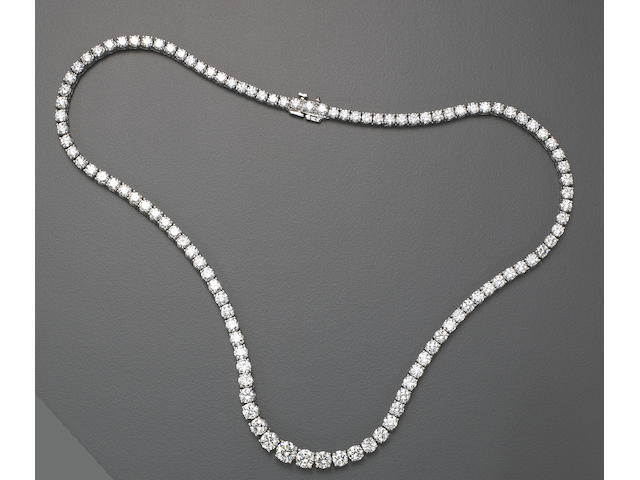 A diamond and eighteen karat white gold necklace